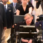 Stephen_Hawking_on_his_way_to_a_lecture_before_highschool_students_in_Jerusalem_10-12-2006